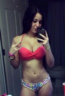 Fabulous brunette teen (18+) student in a picture.