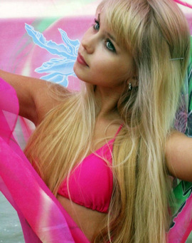 Young Barbie in a pink bra