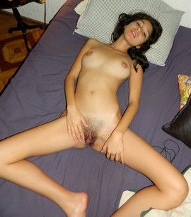 She is ready to have some cock in that nicely trimmed pussy.